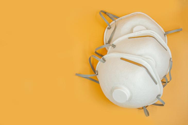 N-95 masks on orange background