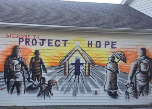 A mural on the side of a building says Project Hope