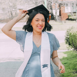 A picture of Nahomy in graduation cap