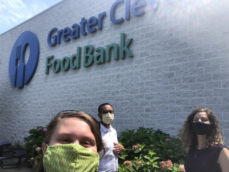 Jenna Thomas and two others in front of Cleveland Food Bank building