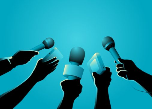 hands with microphones against blue background