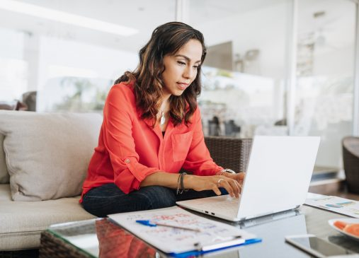 a woman sits in front of a computer