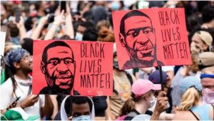 People march in the street demanding justice for the murder of George Floyd.