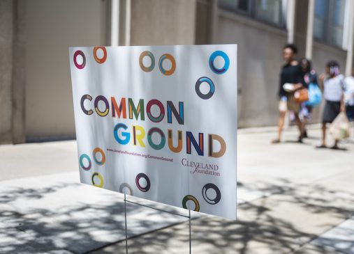 A Common Ground yard sign is pictured outside an event location